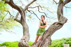 Biracial teen girl on Waikiki beach drawing in the sand Royalty Free Stock Photos
