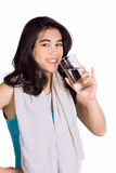 Biracial teenage girl drinking water while exercising Royalty Free Stock Image