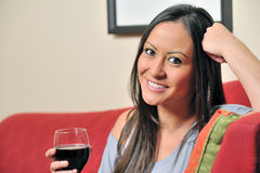 Biracial woman holding a glass of wine Royalty Free Stock Images