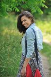 Biracial young woman smiling in the country Royalty Free Stock Photography