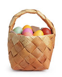 Birch bark basket full of pastel colors easter eggs Stock Photo