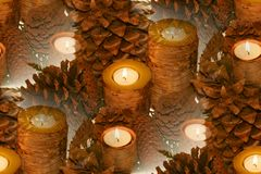 Birch bark candle abstract. Repeated pattern of birch bark candles surrounded by pinecones large and small Stock Image