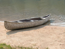 Birch Bark Canoe. A birch bark canoe by the waters edge Royalty Free Stock Image