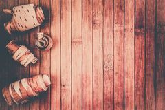 Birch bark rolls on a wooden table. Copy space for text royalty free stock photography