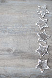 Birch bark stars over the wooden background Royalty Free Stock Image