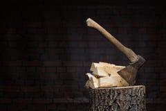Birch firewood, old rusty ax Stock Photos