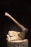 Birch firewood, old rusty ax Royalty Free Stock Photo