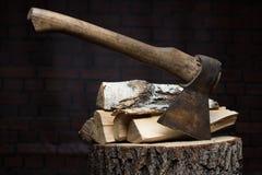 Birch firewood, old rusty ax Royalty Free Stock Photos
