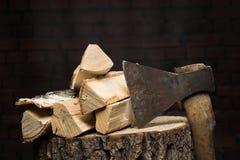 Birch firewood, old rusty ax Stock Image