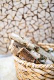 Birch firewood in the wooden basket Royalty Free Stock Image