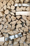 Birch logs are stacked in woodpile Stock Image