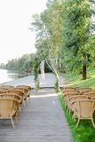 Birch natural arch and chairs in park for wedding. Concept of bridal place for ceremony Royalty Free Stock Image