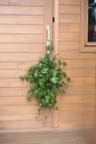 Birch sauna whisk hanging on door handle brown wooden rural baths Stock Images