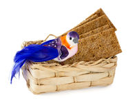 Bird on basket of crackers Royalty Free Stock Photos
