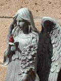 Bird. Hand, red, angel, statue stock photos