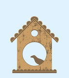 Bird in bird house Stock Image