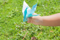 Bird blue paper. In the hands of small children Royalty Free Stock Photos