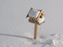 Bird box with snow Stock Image