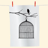 Bird on a branch and birdcage Stock Images