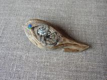 Bird -brooch made from sea wood and glass stock images