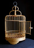 Bird cage. Wooden open cage on black Stock Photo