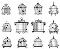 Bird cage. Silhouette of a decorative bird cages Royalty Free Stock Photo