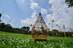 Bird cage. And post in the parks Royalty Free Stock Photo