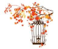 Bird cage among autumn branches Royalty Free Stock Photos