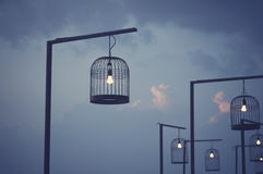 Bird cage decorated as outdoor light post. Royalty Free Stock Photo