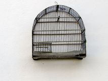 Bird cage. Empty bird cage hanging on the wall Royalty Free Stock Photos