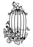 Bird cage among flowers Royalty Free Stock Images