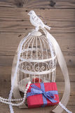 Bird cage and gift box Stock Photography