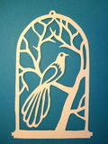 Bird in cage. Paper cutting. Royalty Free Stock Photography