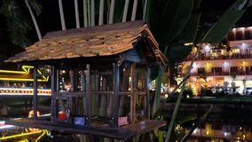 Bird cage by the river, night time.  stock images