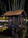 Bird cage by the river, night time.  royalty free stock image