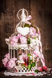 Bird cage with wooden heart Royalty Free Stock Image