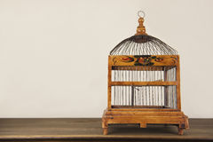 Bird cage on wooden shelf Royalty Free Stock Photos