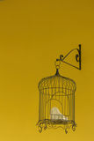 Bird cage on yellow background at the park Stock Images