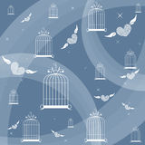 Bird cages on the blue background Royalty Free Stock Images