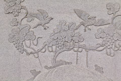 Bird carved on stone wall in chinese temple Royalty Free Stock Photos