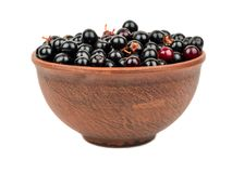 Bird cherry in bowl Stock Photo