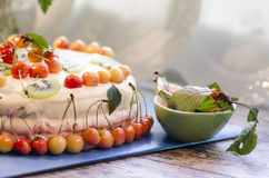 Bird-cherry flour cake with cherries, strawberries and kiwi Stock Image