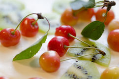 Bird-cherry flour cake with cherries, strawberries and kiwi. Macro. Bird-cherry flour cake with cherries, strawberries and kiwi. Homemade cake stock images
