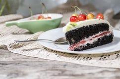 Bird-cherry flour cake served spoon and fresh cherry. Bird-cherry flour cake with cherries, strawberries and kiwi. Homemade cake. From series bird-cherry cake royalty free stock image