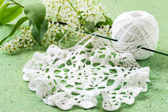 Bird cherry and knitted lace doily Royalty Free Stock Photos