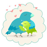 Bird with chick. Two birds. Mother bird hugging her chick Royalty Free Stock Images