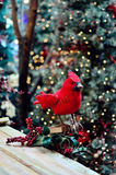 Bird Christmas decoration. With Christmas tree background royalty free stock image