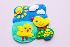 The bird clay toys. Made by hand on the wall Royalty Free Stock Image