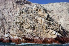 Bird colonies on rocks national park Isla de Ballestas, Peru Royalty Free Stock Images