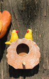 Bird couple toy in their nest Stock Photo